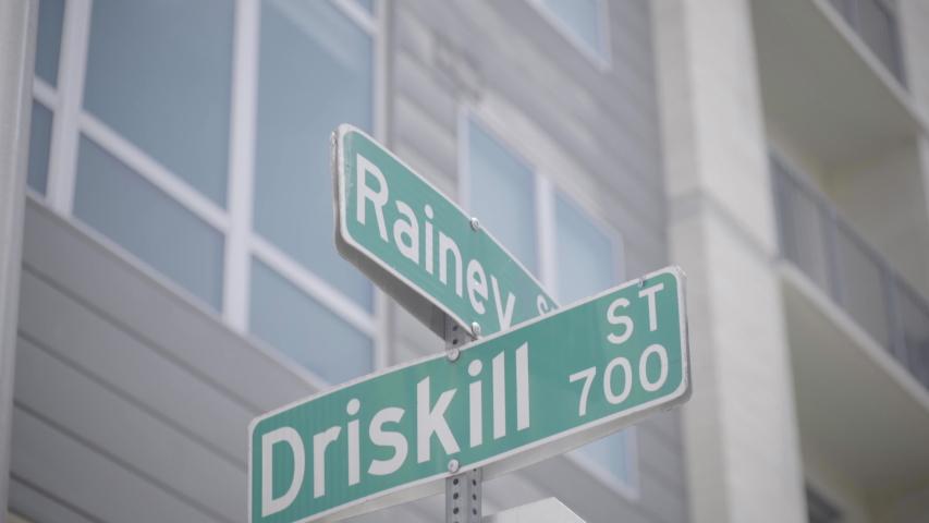 The street signs for Rainey street and Driskill street in Austin, Texas - slight camera movement   Shutterstock HD Video #1030223516