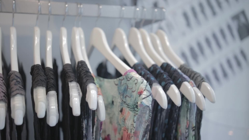 Close up of hanging apparels having different, patterns, cringes and colors | Shutterstock HD Video #1030245302