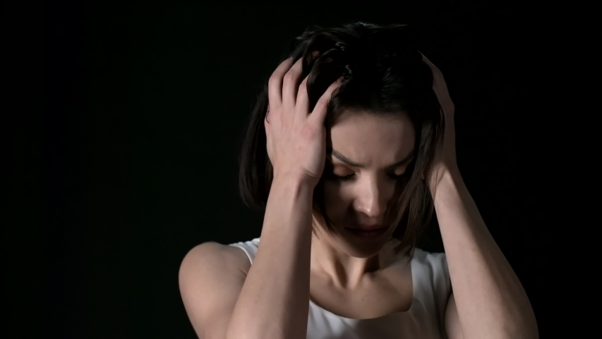 Lockdown of young attractive brunette with short haircut touching her head and hair with her hands in despair | Shutterstock HD Video #1030253822