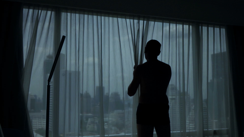 Man unveil curtains and admire view from window at home, slow motion | Shutterstock HD Video #1030263002