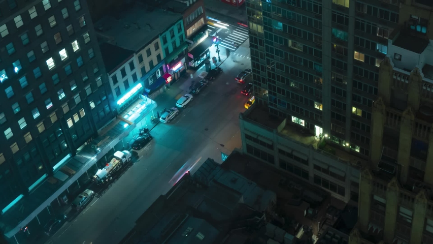 Top down shot of busy new york at night. Time Lapse | Shutterstock HD Video #1030273031