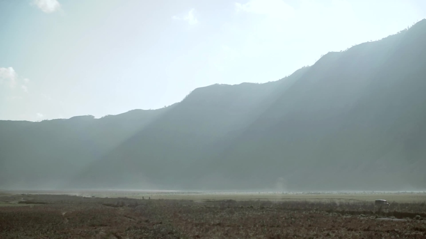 Plateau landscape from bromo mountain in the misty morning footage | Shutterstock HD Video #1030281314