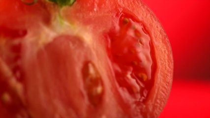 Tomato. Ripe natural tomatoe close-up. Organic tomato rotating on red background. Macro shot. Half of Tomato close-up. Garden, Gardening concept. Slow motion 4K UHD video