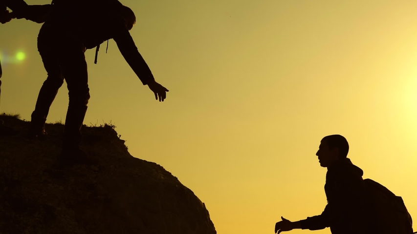 Climbers silhouettes stretch their hands to each other, climbing to top of hill. teamwork of business people. travelers climb one after another on rock. joint business. Slow motion | Shutterstock HD Video #1030352432