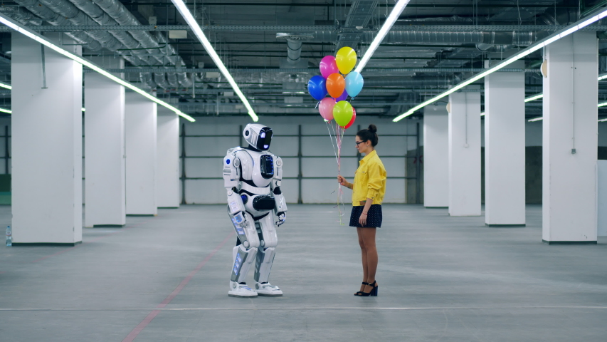 One girl gifts lots of colorful balloons to her friend droid. | Shutterstock HD Video #1030374356