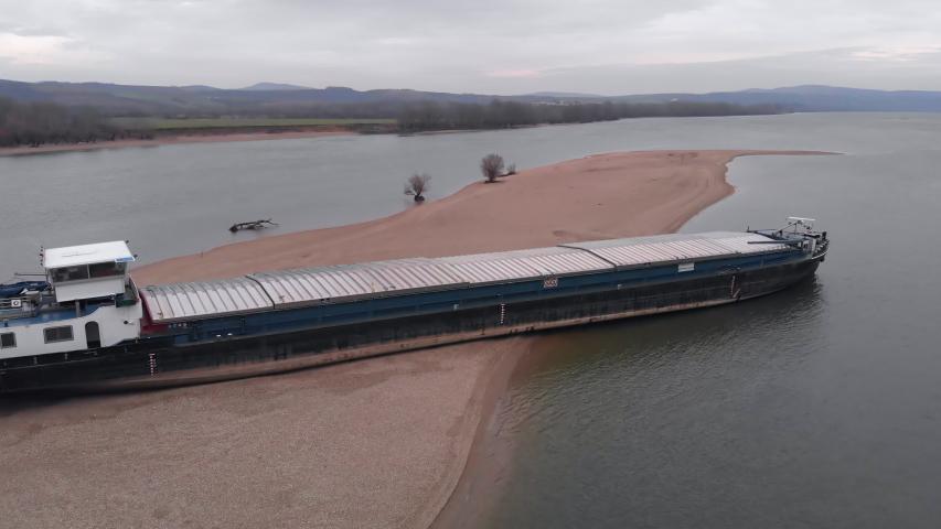 Esztergom, Hungary - 02 02 2019: Stranded Romanian Cargo Vessel. Ezstergom, Hungary. 02 February, 2019.