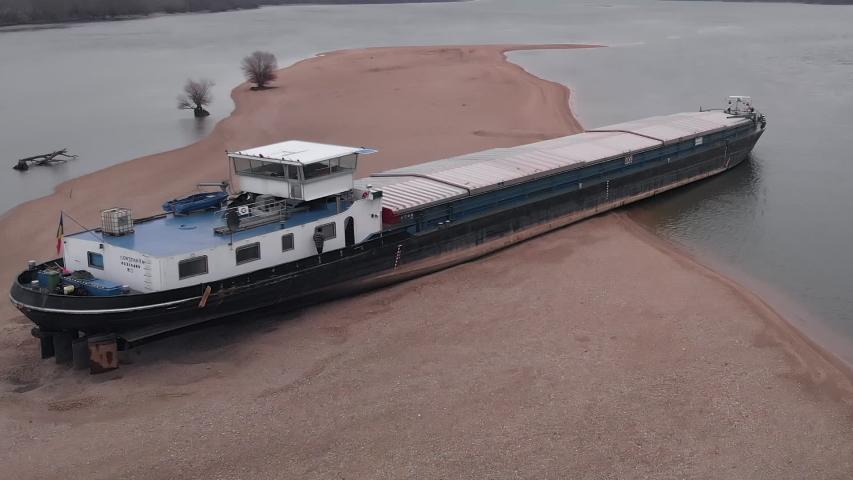 Esztergom, Hungary - 02 02 2019: Jess, Romanian Cargo Barge Ran Aground on Danube River. Esztergom, Hungary. 02 February, 2019.