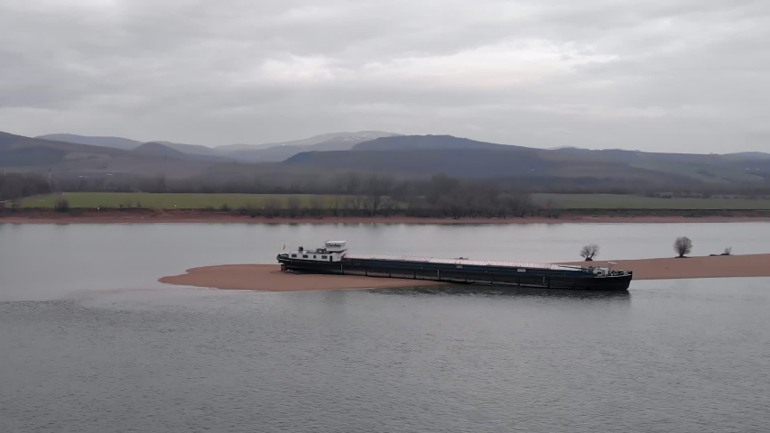 Romanian Barge Trapped on Danube River Sandbank. Aerial View.