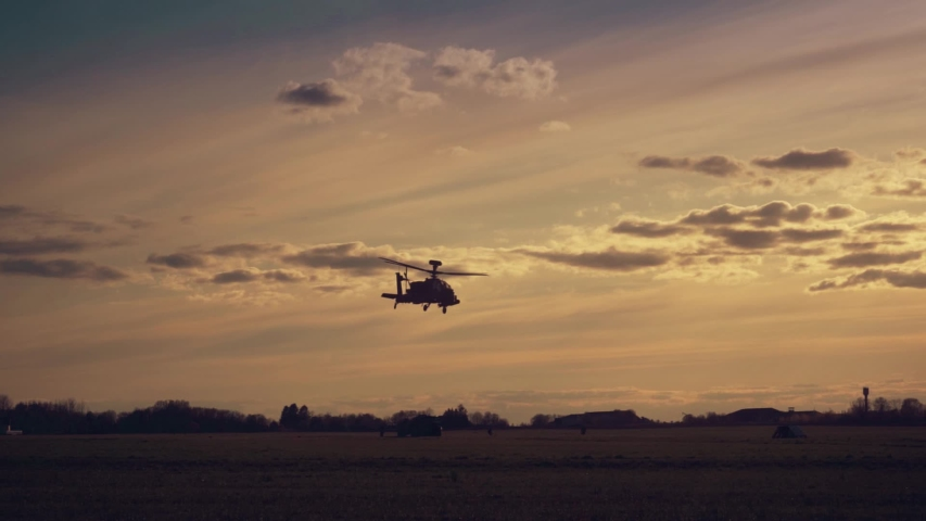 Military helicopters flies overhead passing in slow motion.   Shutterstock HD Video #1030391384