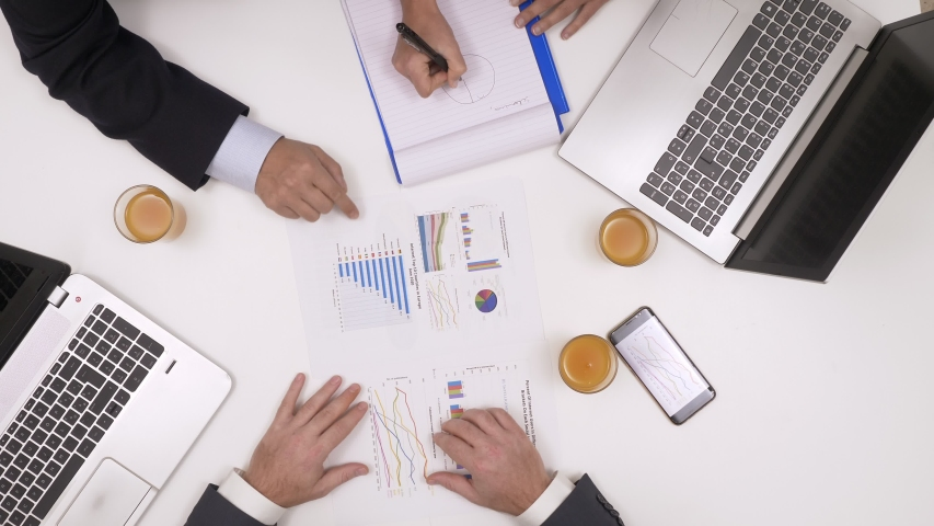 Top view of hands. Business team checking financial charts and graphs, working #1030391885