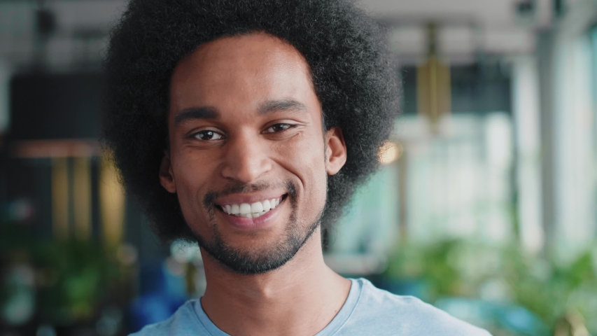 Portrait of African man with big smile on his face   Royalty-Free Stock Footage #1030392764