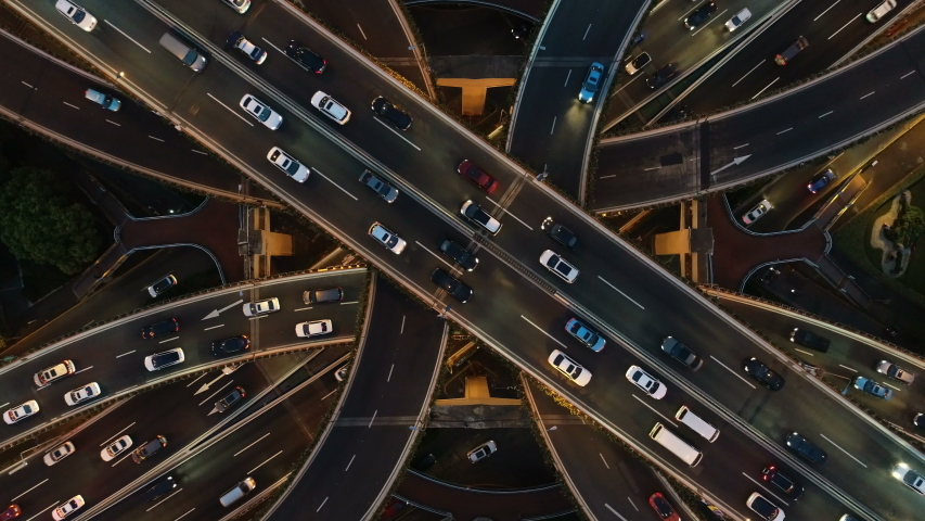 Overhead drone shot of cars driving over elevated highway and busy interchange in Shanghai, China | Shutterstock HD Video #1030403975