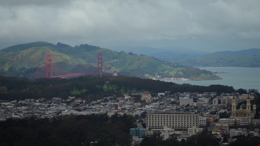 View of the cityscape of San Francisco, with the Golden Gate Bridge, on a cloudy, foggy day. Shot on a Canon C200 in 4K in San Francisco in 2019.