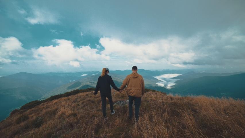 The man and woman walking on the beautiful mountain   Shutterstock HD Video #1030416047
