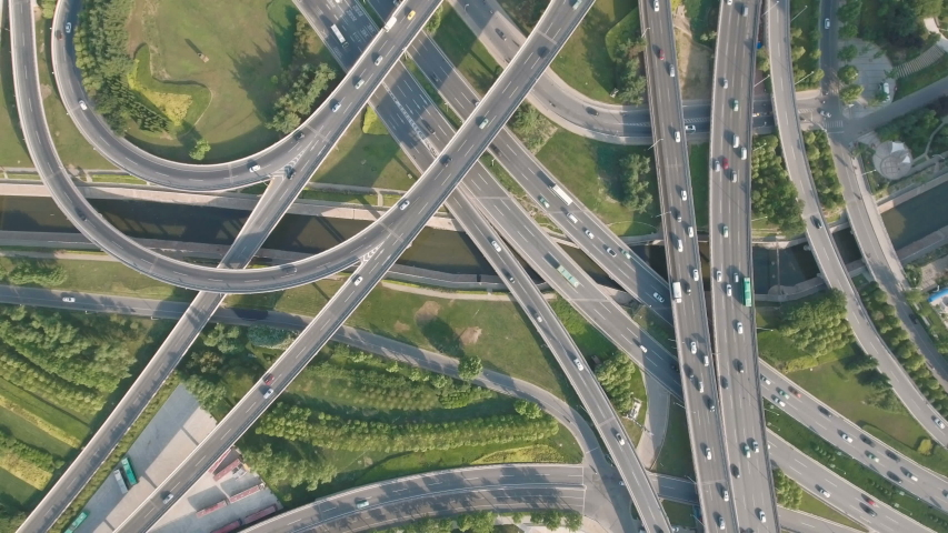 Panoramic aerial footage of a huge network of flyovers, junctions, intersections, roads, bridges etc in Zhengzhou, urban China | Shutterstock HD Video #1030441718