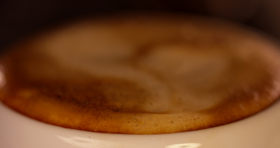 Froth Popping On The Top Of A Mug Full Of Espresso.Italian Roast Coffee Beans. Hot Delicious Beverage. Authentic Coffee Machine. Coffee Shop. Barista Working.Blurred Focus Into Focus | Shutterstock HD Video #1030453313