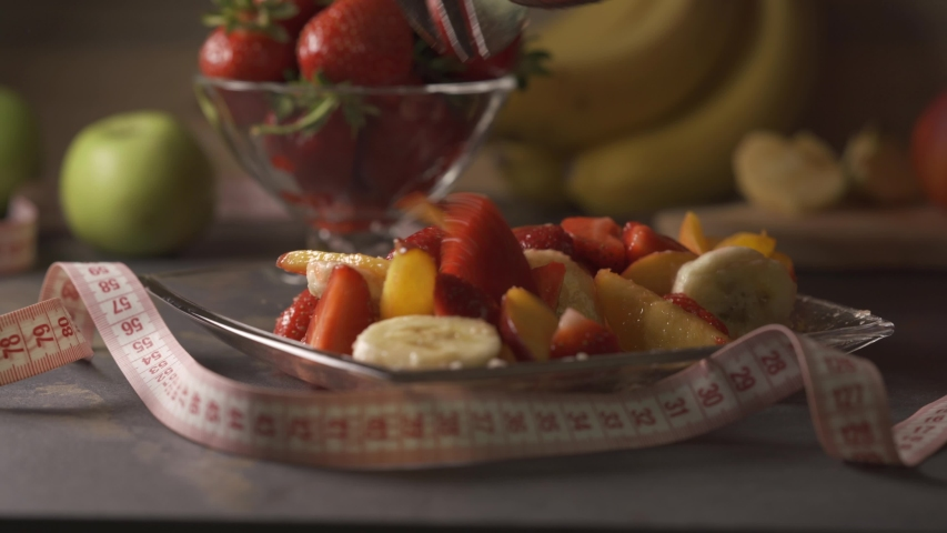 Weight Loss. Healthy and organic fruit salad. Concept of: fitness, diet, wellness and breakfast. Assorted coloful fruits. Home cooking. | Shutterstock HD Video #1030461362