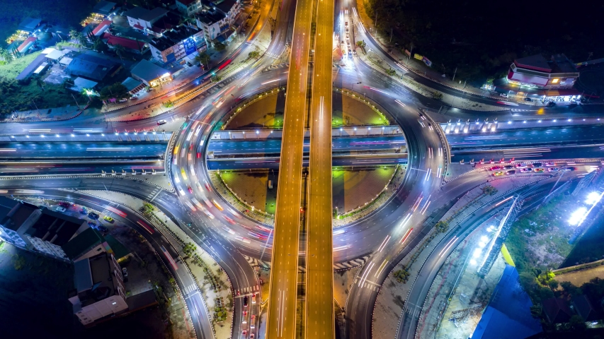4K Aerial view Time lapse of the circular intersection expressway, highway in the traffic for transportation over intersection bridges and ring road | Shutterstock HD Video #1030471307