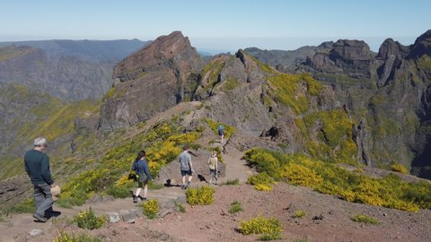 Tourists hiking in the foot path of Pico Areeiro, Madeira Island, Portugal, May 2019