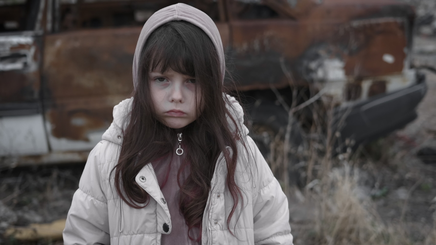 Portrait of a refugee child. Sad homeless little girl. | Shutterstock HD Video #1030561142