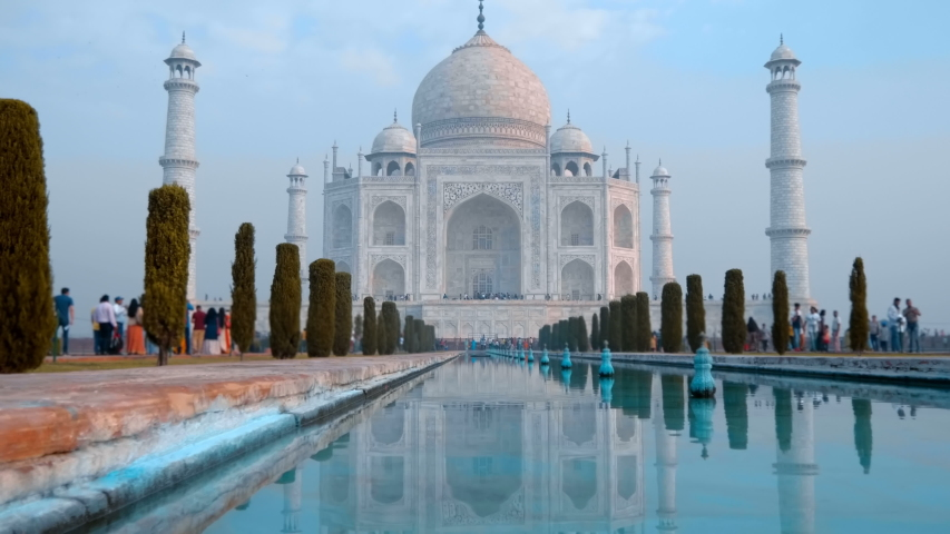 Taj Mahal - a mausoleum mosque, combines elements of Indian, Persian and Arab architectural styles, located in Agra, India, on the banks of the Yamuna River. Shot in motion