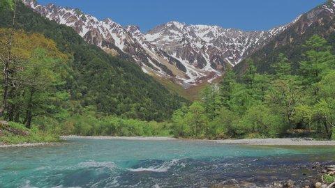 Hodaka mountain of fresh green season and river flowing in Kamikochi, Nagano, Japan.