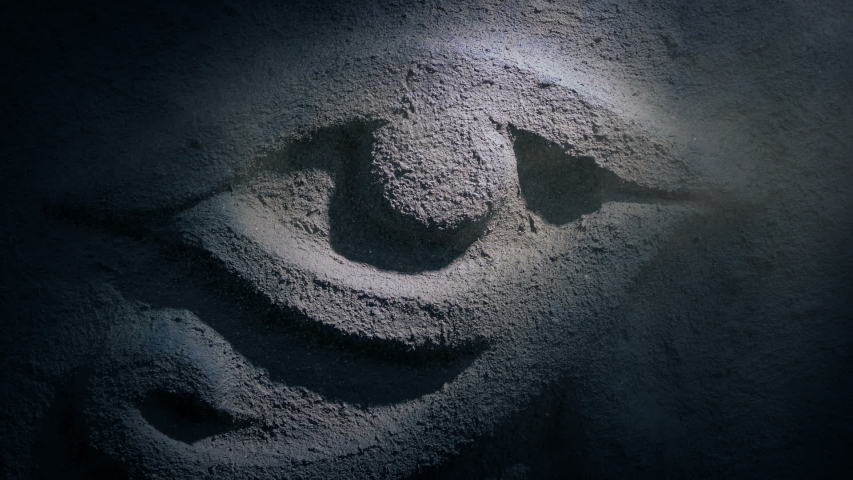 Torch Shines On Egyptian Eye Rock Carving