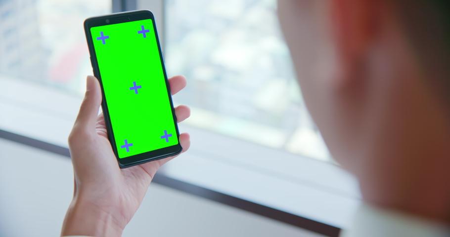 Buisnessman show cellphone green screen in backview   Shutterstock HD Video #1030671779