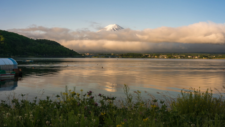 Time-lapse Fuji mountain and Kawaguchiko lake in morning, fog flow on the air and people do activity. | Shutterstock HD Video #1030674323