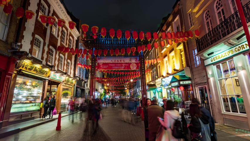 LONDON / UK - NOVEMBER 21, 2018: Time lapse zoom in view of Chinatown in London with at night with lights shifting color | Shutterstock HD Video #1030676597