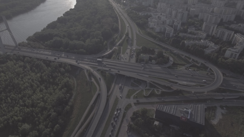 Top view downward of the drone shows an impressive highway elevation and the convergence of roads, bridges, viaducts in Warsaw during the day, the development of transport and infrastruc. 4K. RAW  | Shutterstock HD Video #1030682309