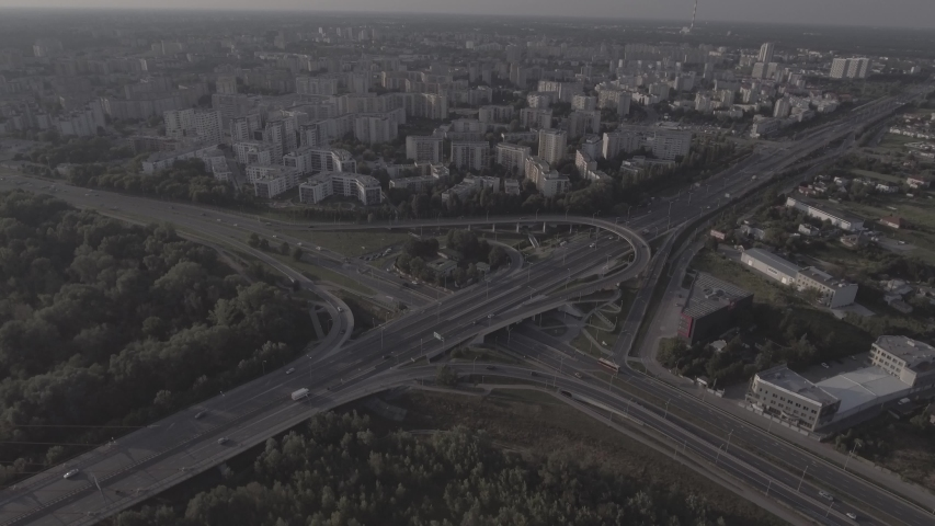 Top view downward of the drone shows an impressive highway elevation and the convergence of roads, bridges, viaducts in Warsaw during the day, the development of transport and infrastruc. 4K. RAW  | Shutterstock HD Video #1030682315