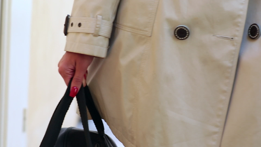 Close up legs of young adult woman holding black bag and walking on street  | Shutterstock HD Video #1030687115