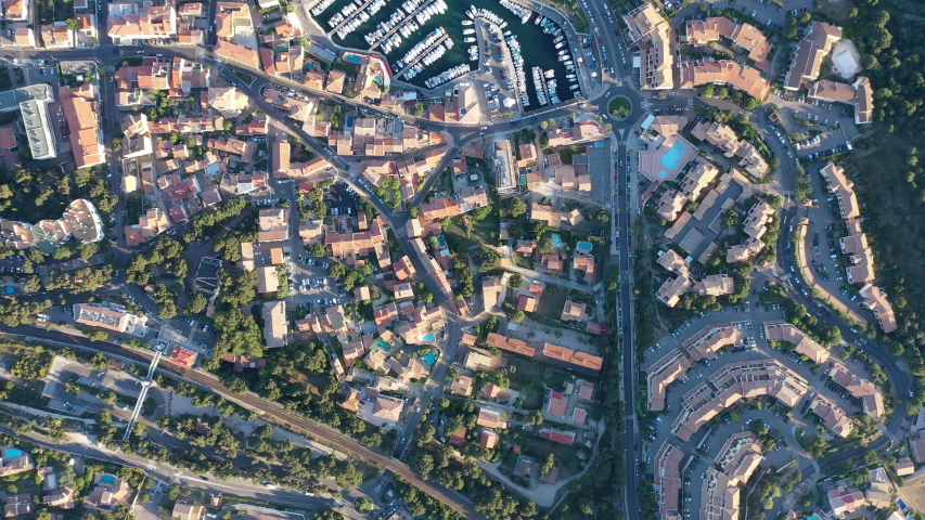 Top aerial drone view of Sausset  les Pins harbor and city center. Mediterranean city France sunset blue water
