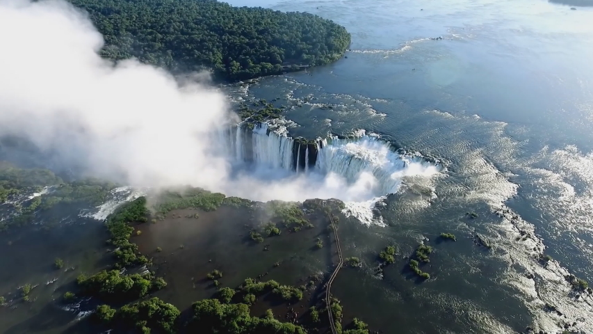 The Iguazu Falls are waterfalls of the Iguazu River on the border of Argentina and Brazil. They are the largest waterfalls system in the world. (aerial photography) | Shutterstock HD Video #1030691465