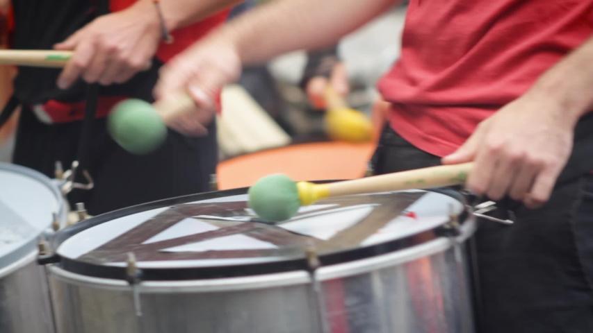 Brazilian batucada playing drums. Dress in red | Shutterstock HD Video #1030694456