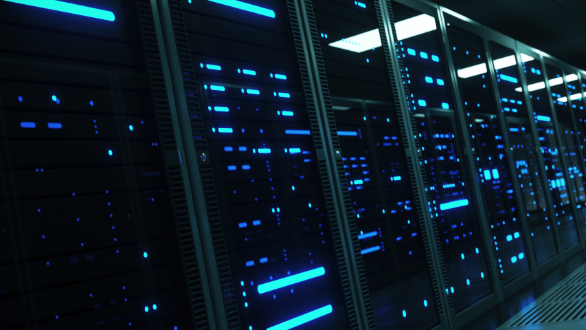 Powerful servers sit behind glass panels in a server room of a data center or ISP as the camera moves at an angled dolly shot, 4K high quality animation Royalty-Free Stock Footage #1030696301