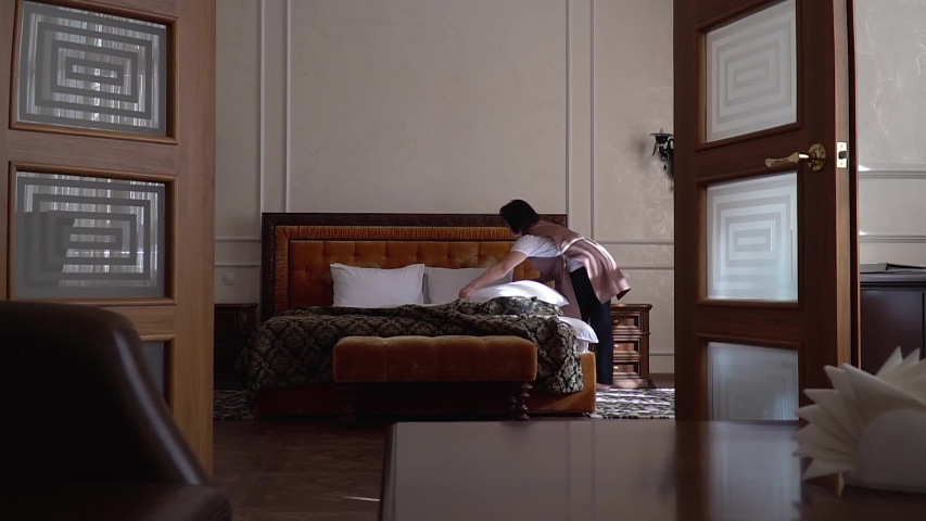 The maid cleans the hotel rooms | Shutterstock HD Video #1030702313