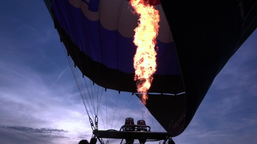 Close up slow motion video of propane gas fire burner in hot air balloon for take off