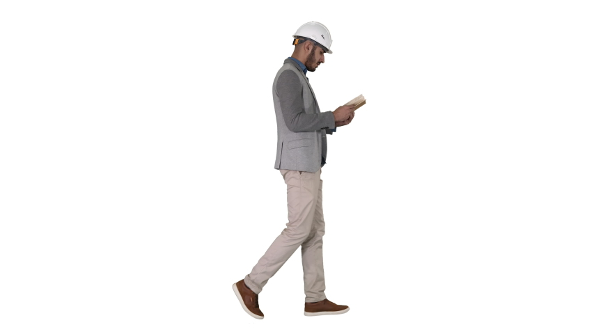 Young architect reading textbook or notebook while walking on white background. | Shutterstock HD Video #1030717799