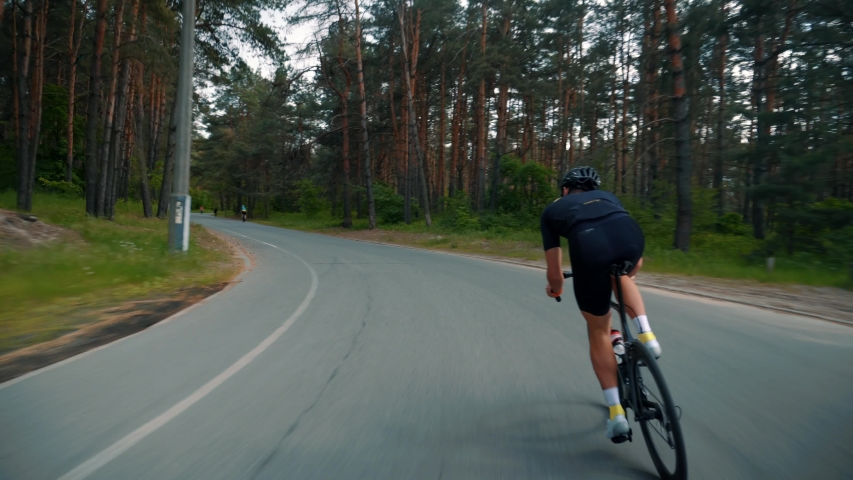 Hard Sport Workout.Triathlete Cyclist Training On Bicycle.Fit Athlete Sport Workout Training Cycling Triathlon Competition.Cyclist Fitness Riding On Road Bike Ready For Triathlon Race.Recreation Sport | Shutterstock HD Video #1030724486