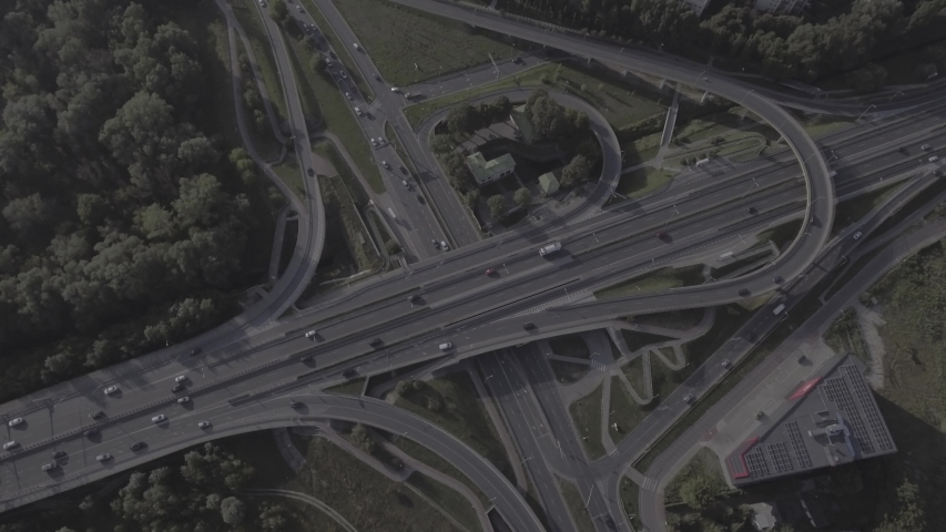 Aerial view of the network of overpasses, junctions, intersections, roads, bridges on the outskirts of Warsaw. Filmed from 4K drone in RAW. Video for post-processing. | Shutterstock HD Video #1030737473