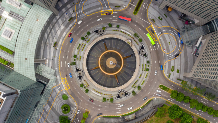 Hyperlapse or Dronelapse top view fly over the Singapore landmark financial business district with skyscraper. Fountain of Wealth at Suntec city in Singapore. Circle of traffic in center of business. | Shutterstock HD Video #1030739048
