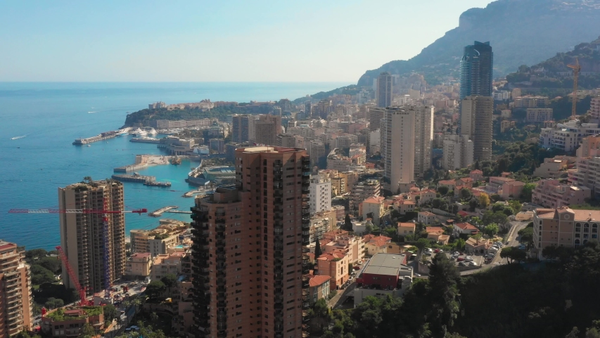 France, Monaco, Larvotto, drone aerial view. Monte Carlo Sea Land Project extension works, mediterranean expansion, in the background. | Shutterstock HD Video #1030773326