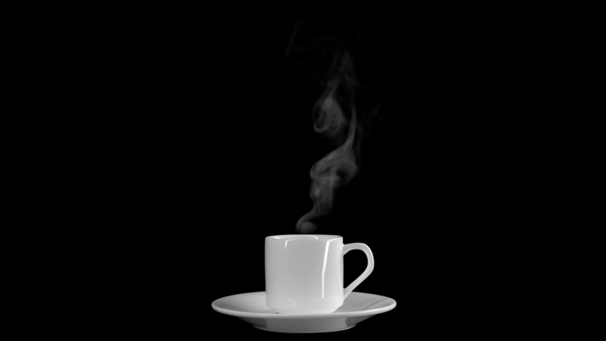 Steam from a cup with boiling water. A trickle of steam rises from a cup of hot coffee. Absolutely black background, you can use to overlay an object. Steam over a cup of hot coffee.