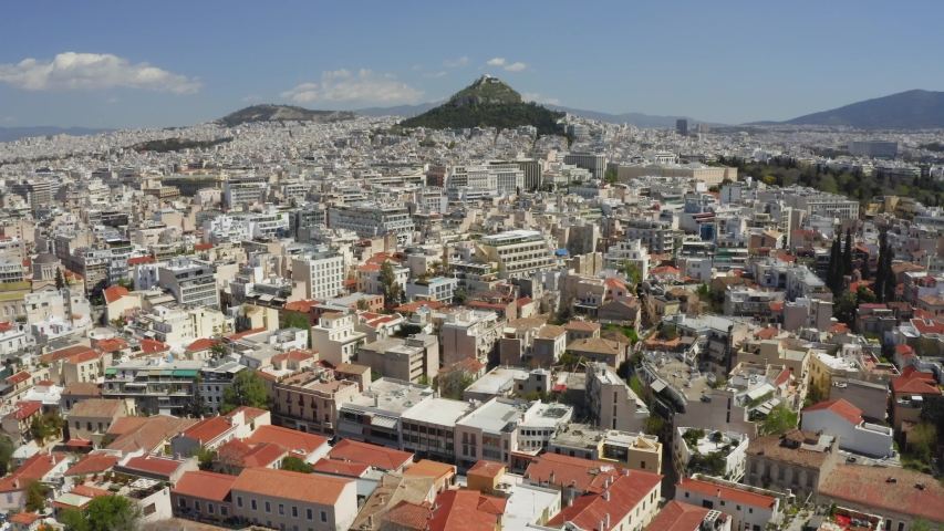 Aerial view of Mount Lycabettus and Parliament Building in Athens, Greece. Drone shot / bird's eye. | Shutterstock HD Video #1030783538