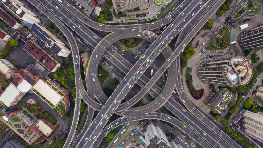 Aerial point of drone view 4k time lapse scene traffic on elevated express road in urban area in Shanghai China in day time
