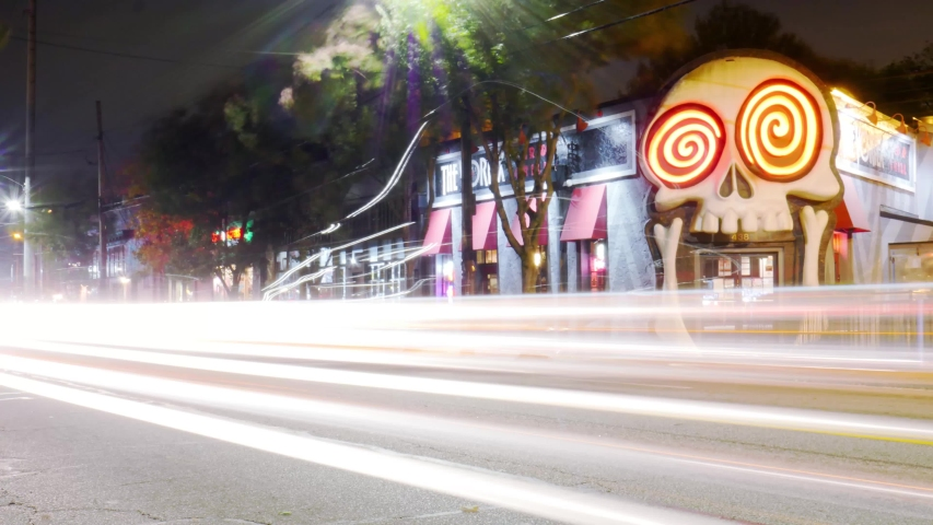 Atlanta, GA / United States - 11 15 2018: Atlanta, GA - November 16, 2018: Wide shot of traffic passing The Vortex restaurant in the Little Five Points area of Atlanta on a cold night late in fall.