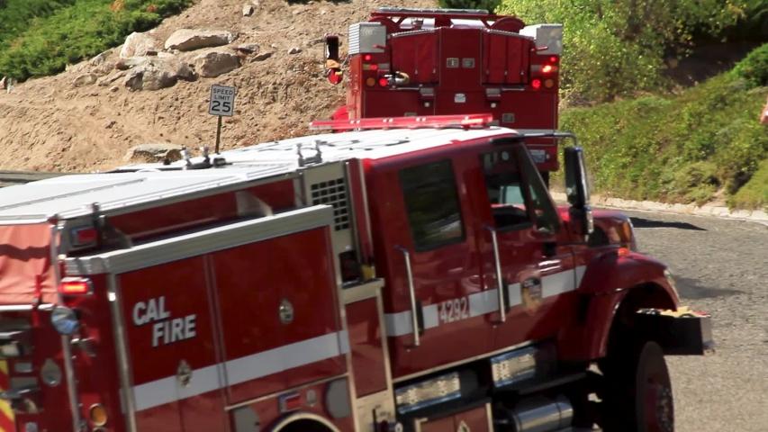 Oakhurst, CA / United States - 01 02 2019: Firetrucks racing through California small town