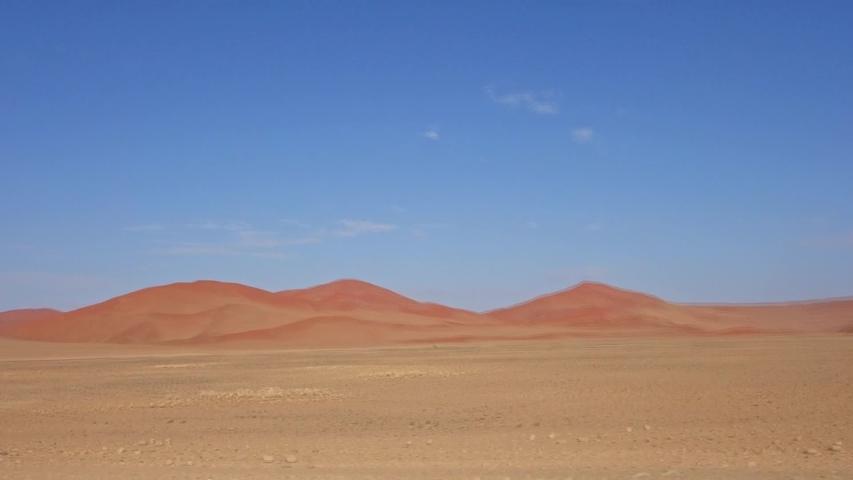 On the road in Sossuvlei. In motion. Namibia desert. #1030816901